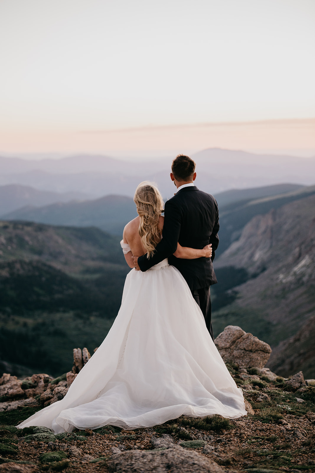 Couple enjoying the sunset during their Rocky Mountain wedding