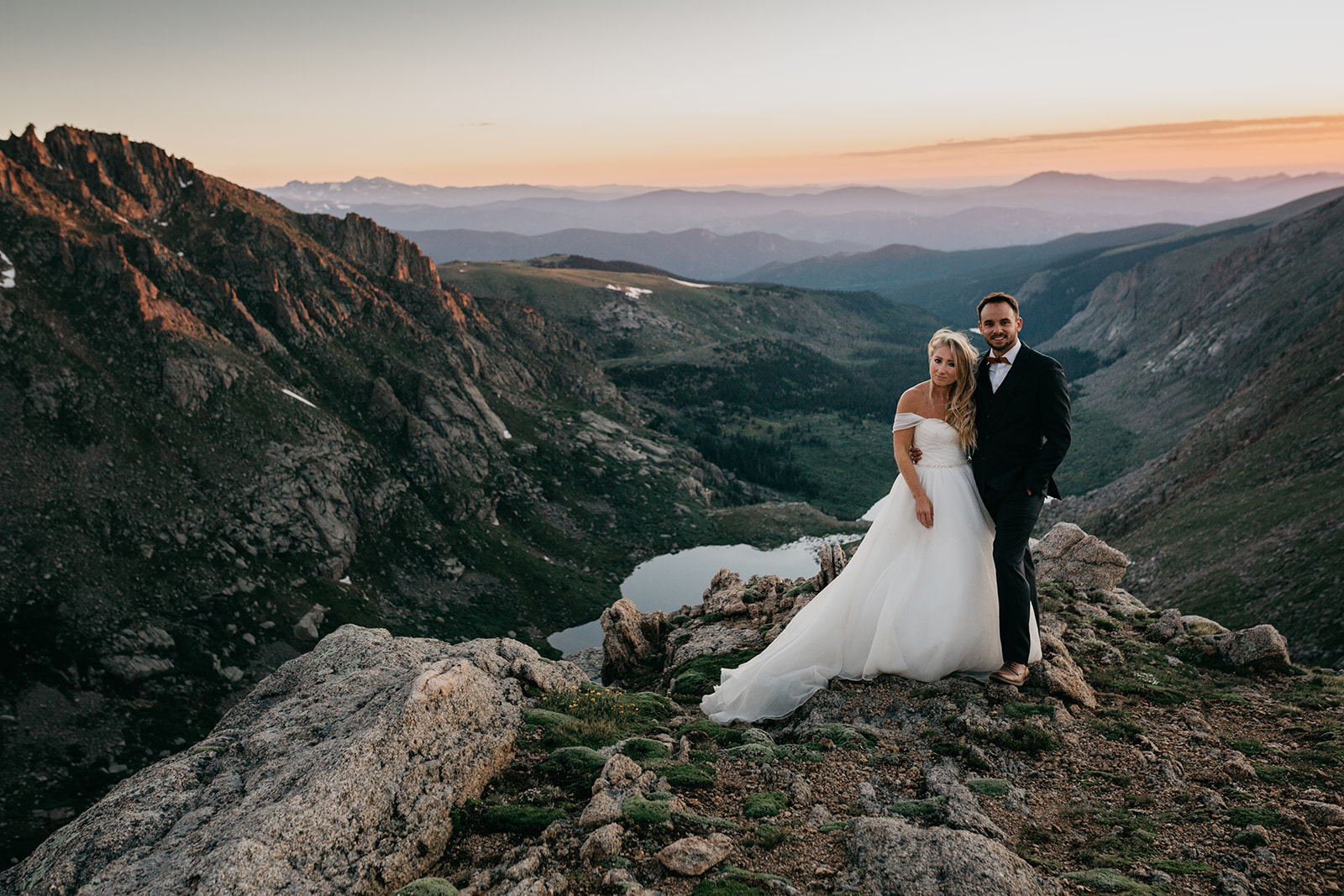 Couple enjoying the sunset during their mountain wedding