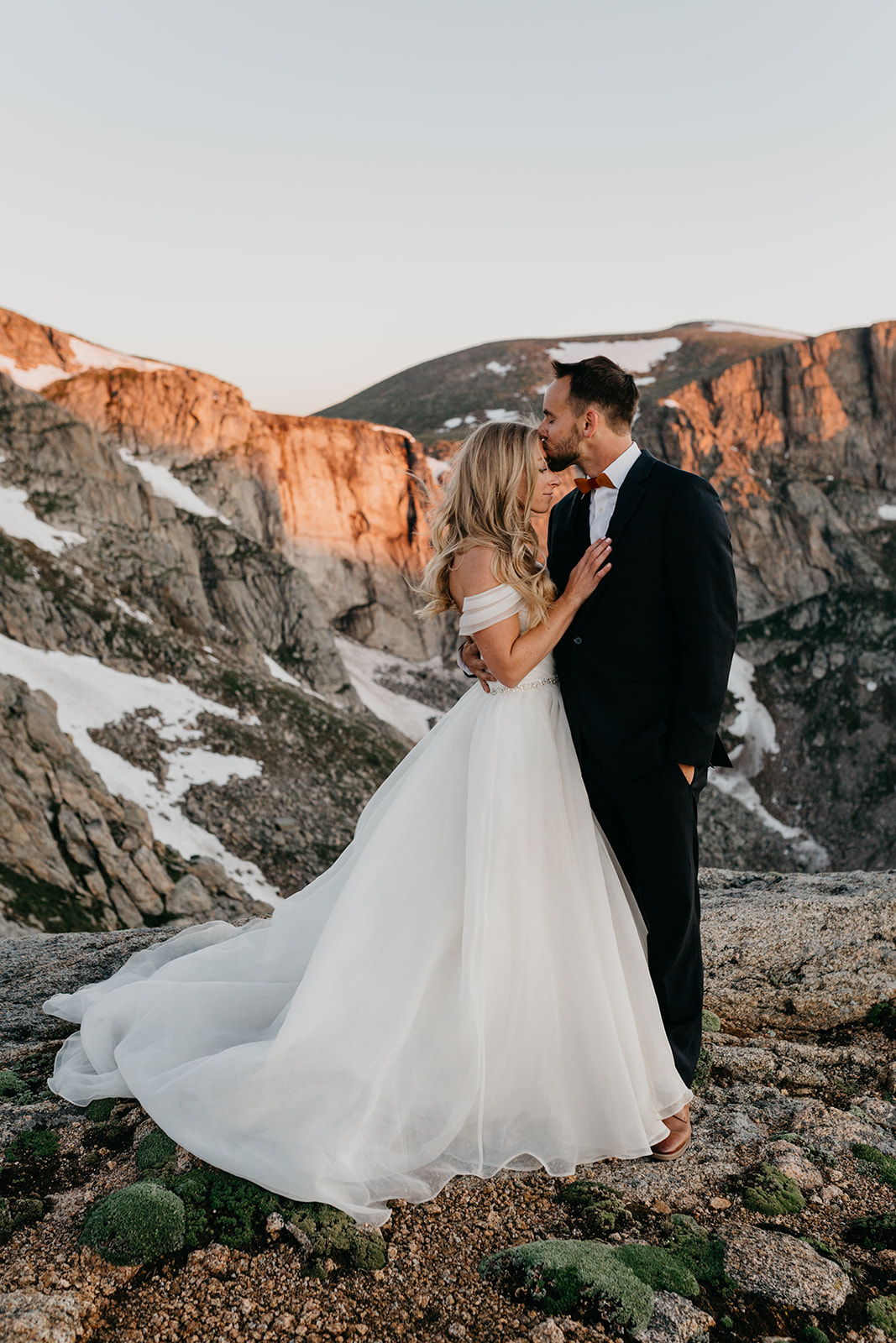 Bride and groom kissing at their rocky mountain wedding