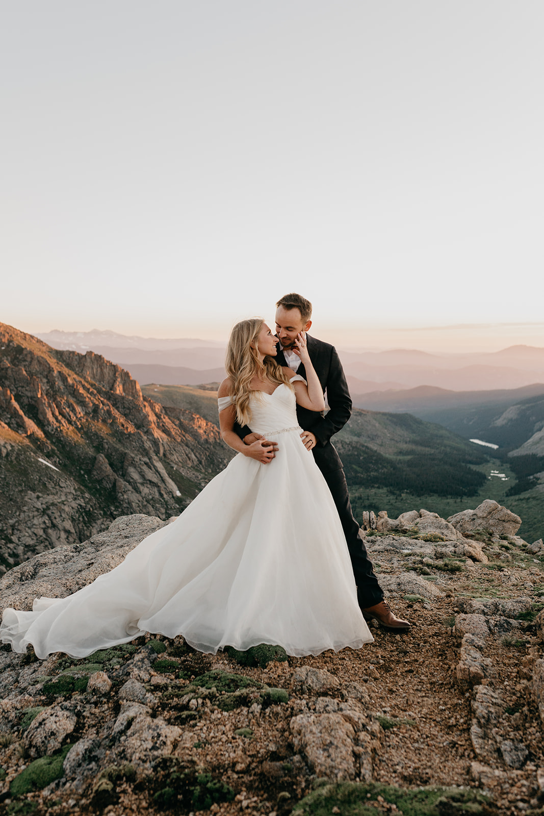 Couple kissing during sunset during their rocky mountain wedding