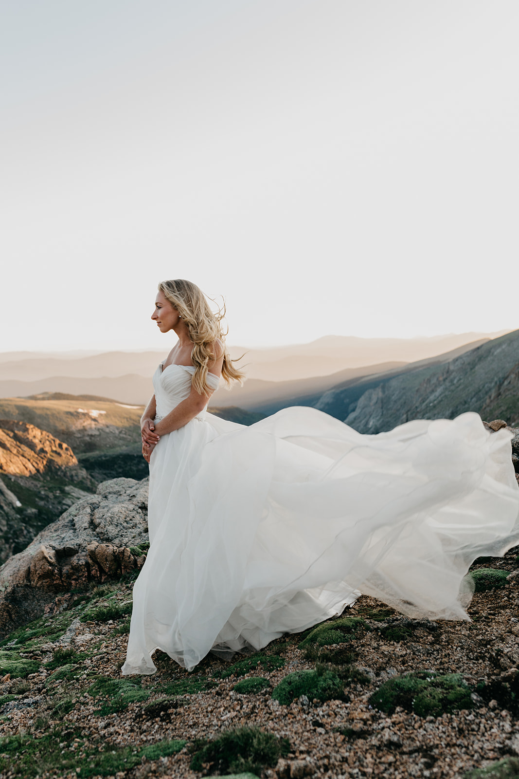 Bride enjoying sunset during her rocky mountain wedding