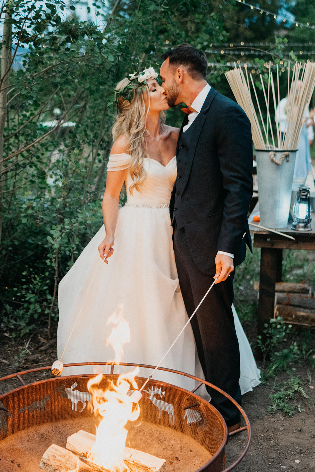 Couple roasting smores at their wedding