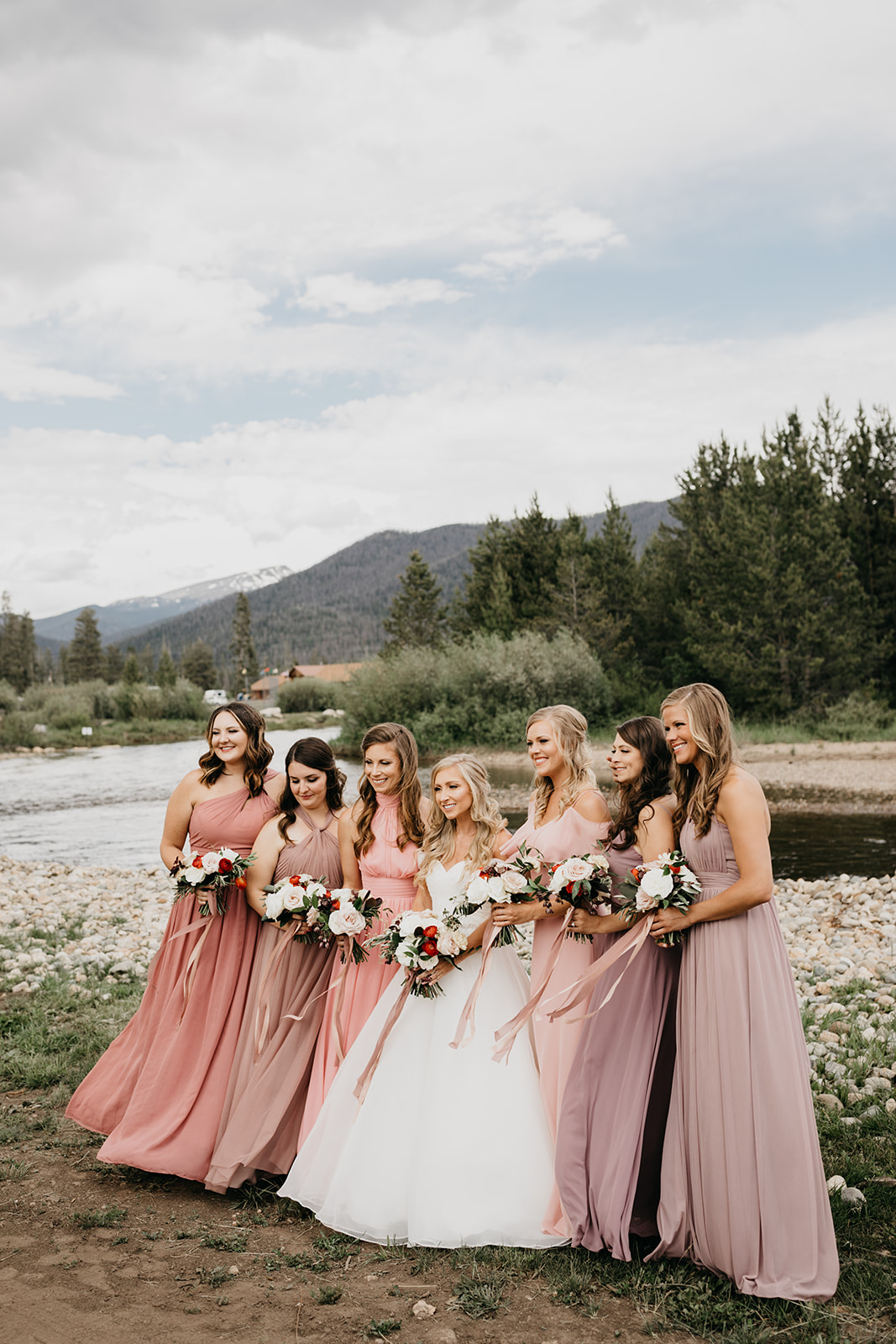 Bridesmaids smiling before a Rocky Mountain wedding