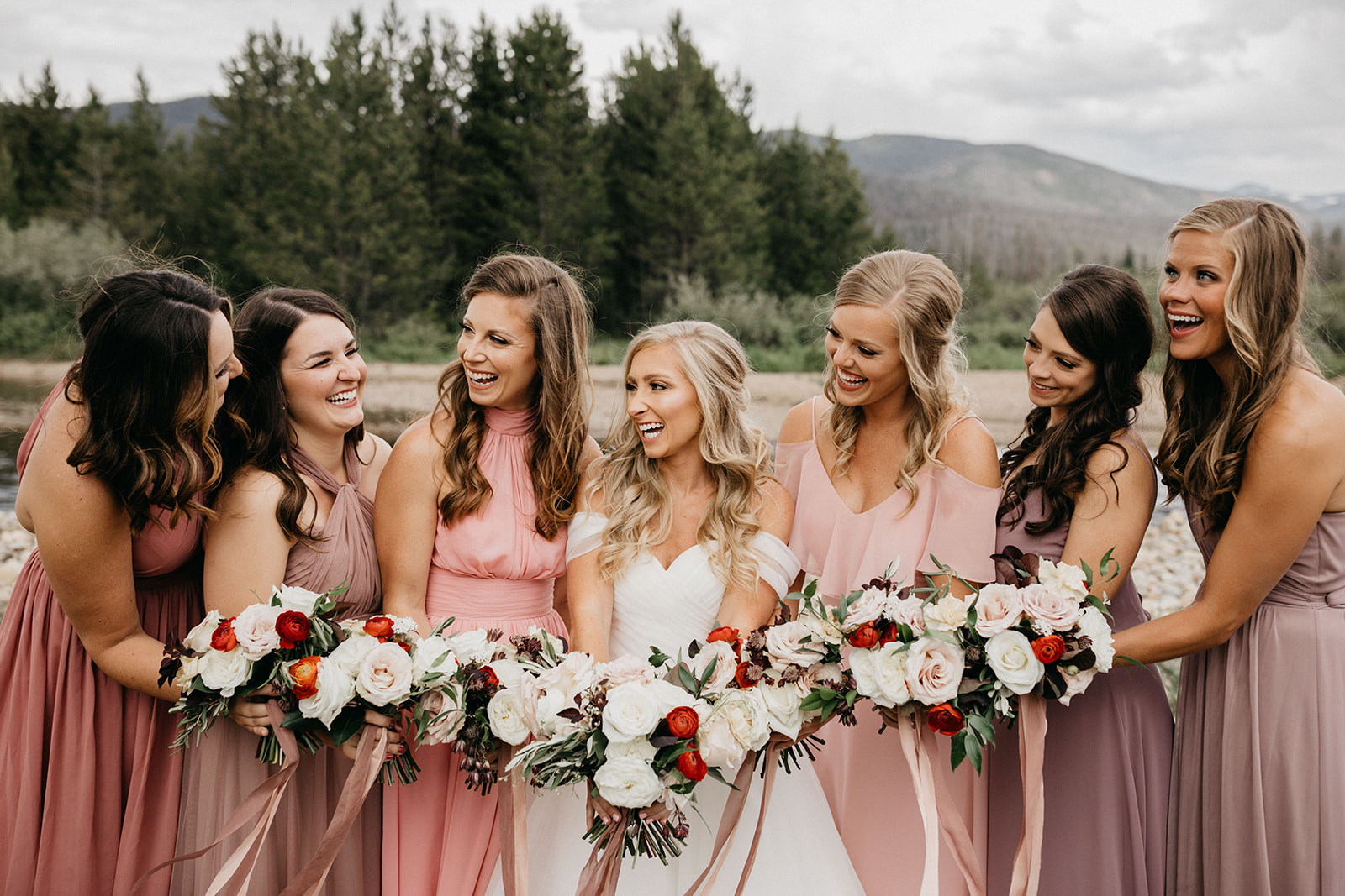 Bridesmaids smiling before a Grand Lake, CO wedding