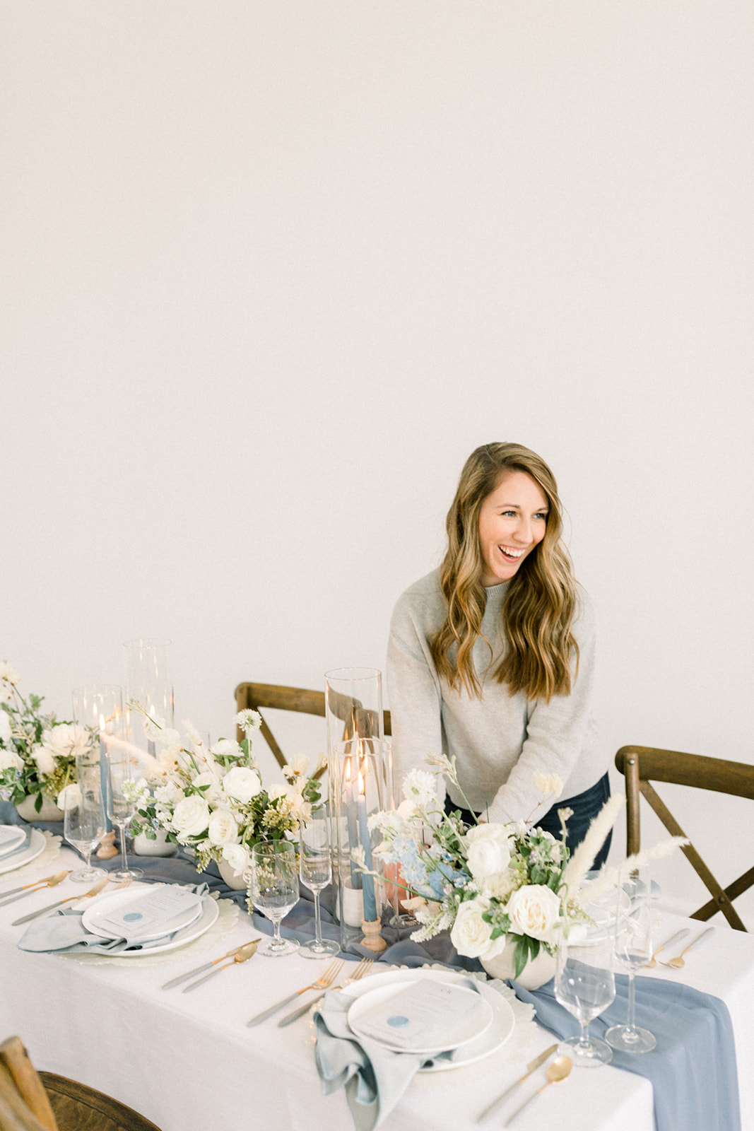 Michigan wedding planner setting a table for a wedding