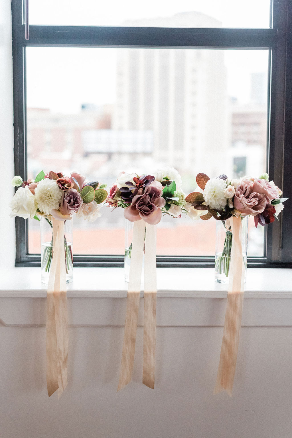 Bouquets sitting on a ledge