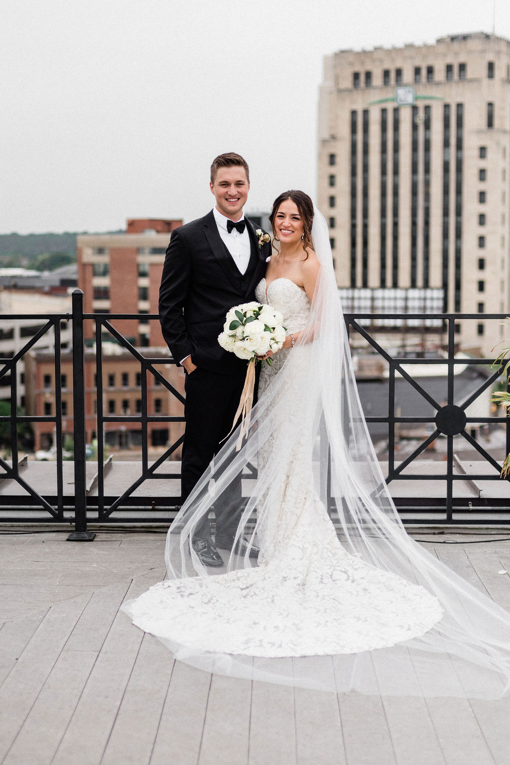 A bride and groom smiling during their downtown kalamazoo wedding