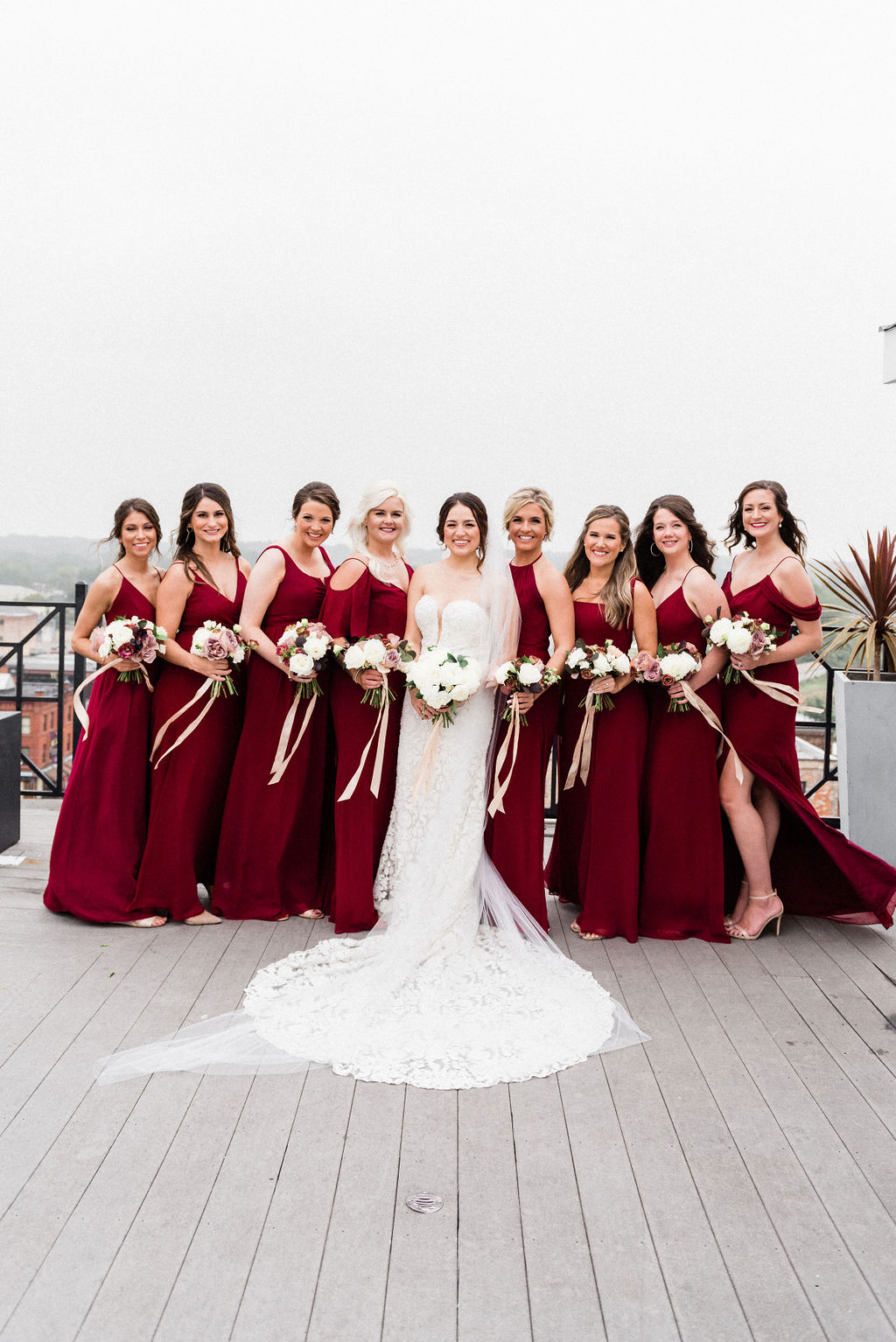 A bride and her bridesmaids smiling before her wedding