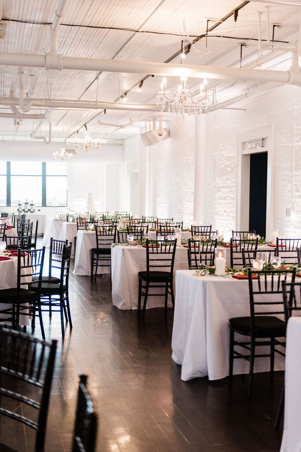 Tables set for a downtown kalamazoo wedding at Loft 310