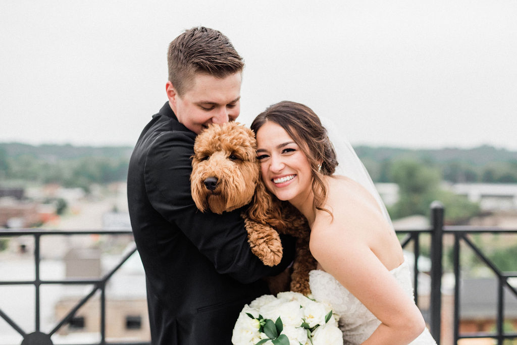 A couple and their dog before their downtown kalamazoo wedding