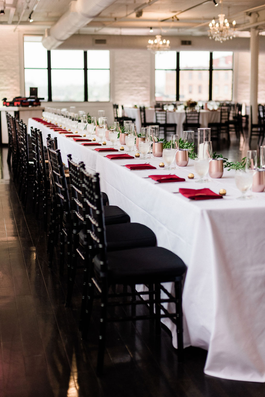 Tables set for a loft 310 wedding