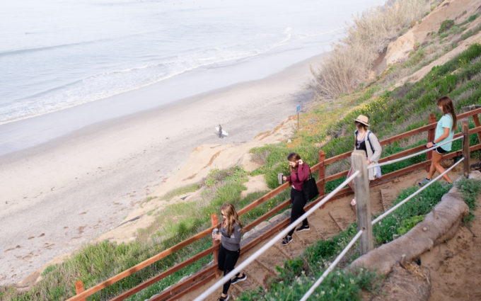 Entrepreneurs gathering at Beacons Beach for a San Diego Business retreat in Encinitas, CA