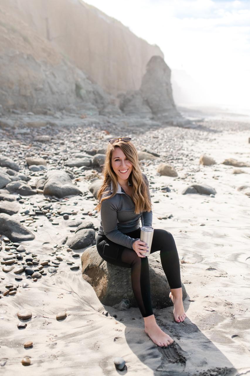 A girl enjoying the sunrise at Beacons Beach in Encinitas, CA
