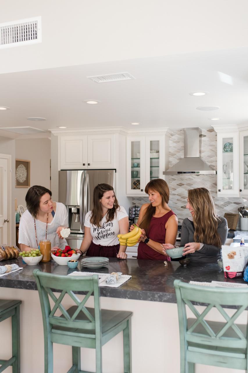 Women enjoying making breakfast