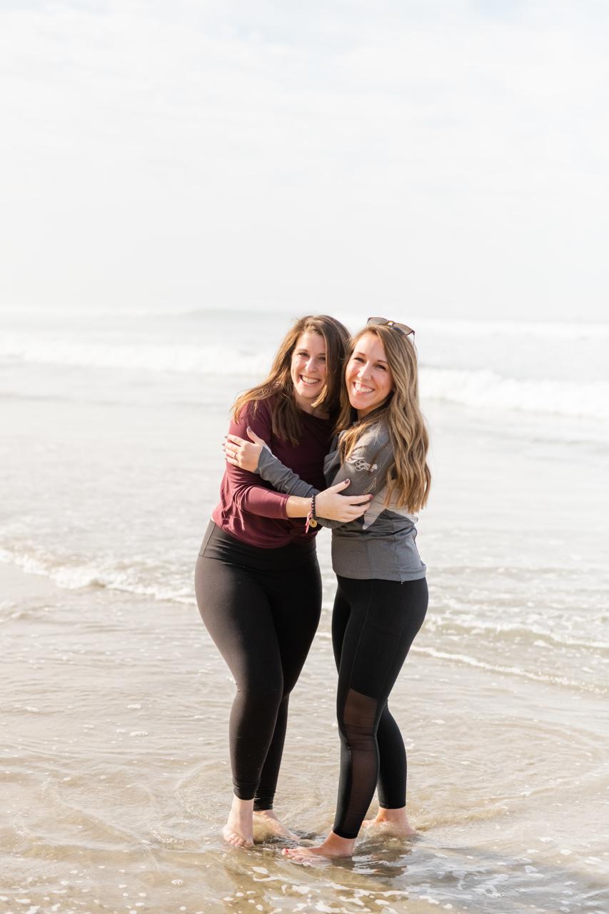 Two girls hugging at Beacons Beach in Encinitas, CA