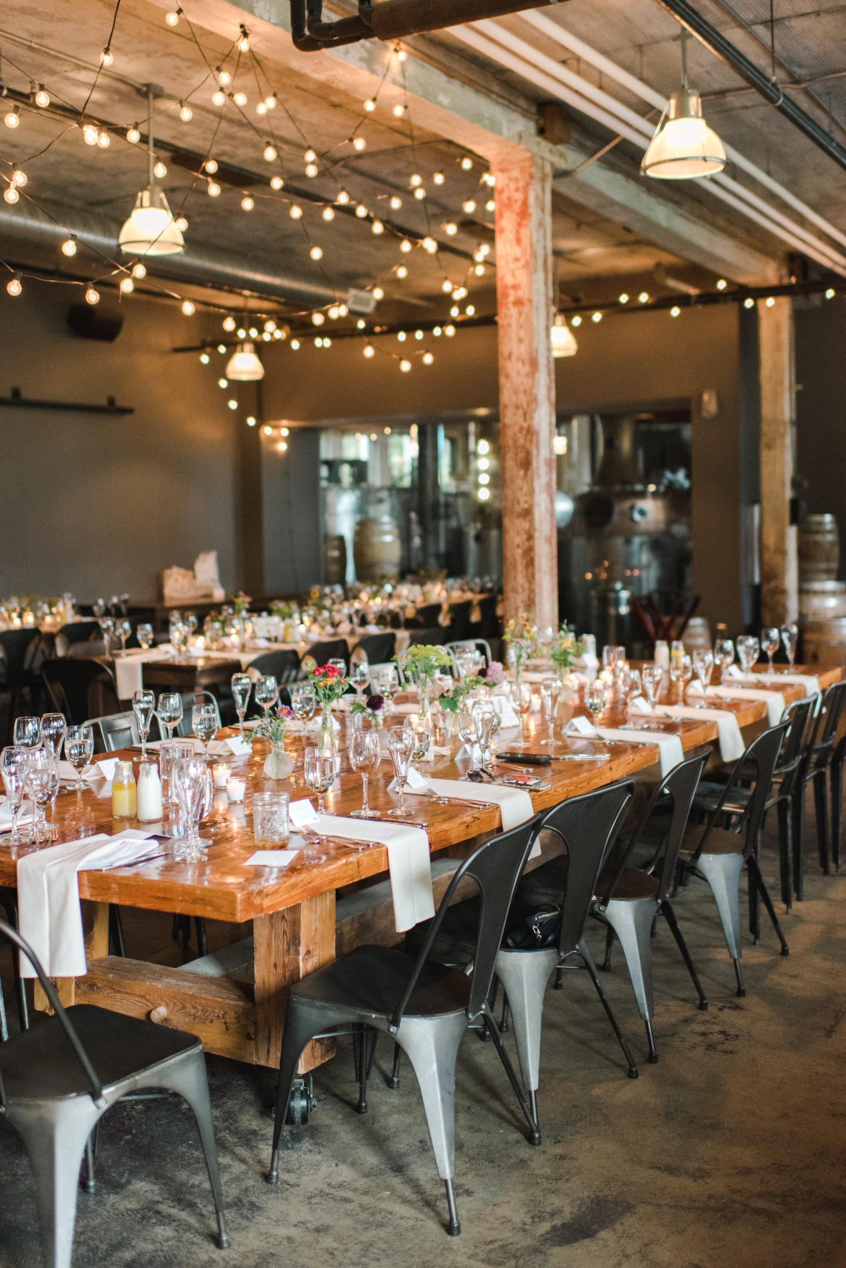 Tables set for a Journeyman Distillery wedding
