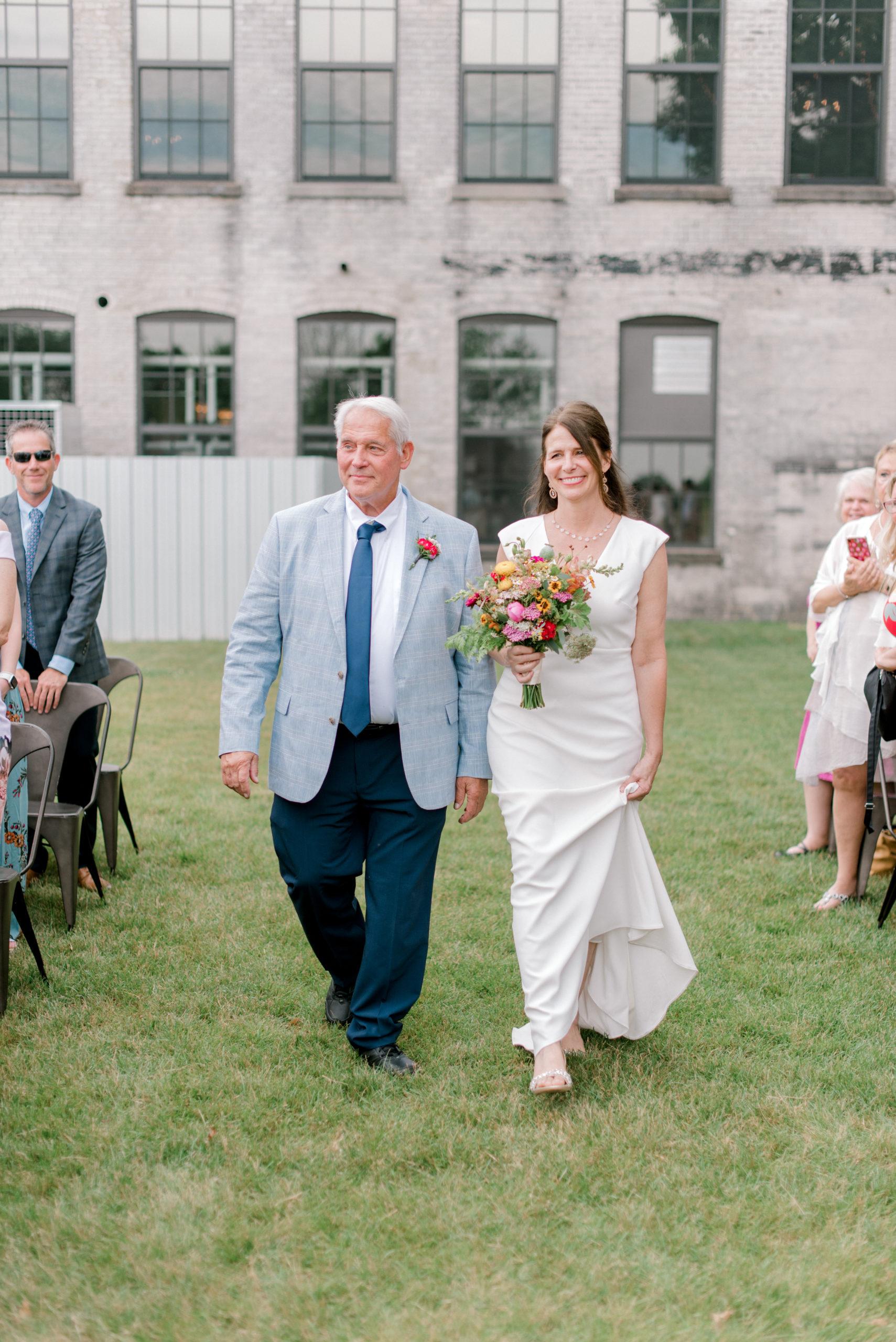 Bride smiling during her Journeyman Distillery wedding