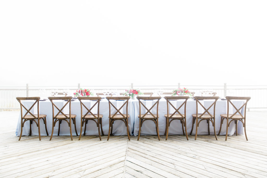 Table set on the deck for Camp Blodgett wedding in West Olive, Michigan