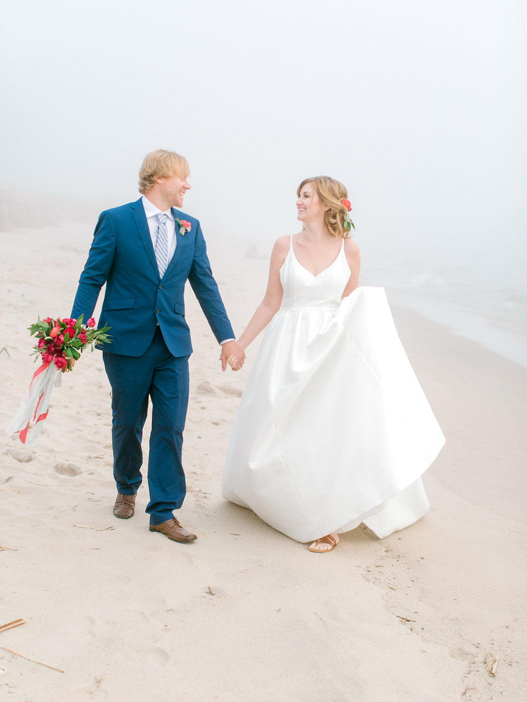 Couple walking down the beach during their Lake Michigan wedding