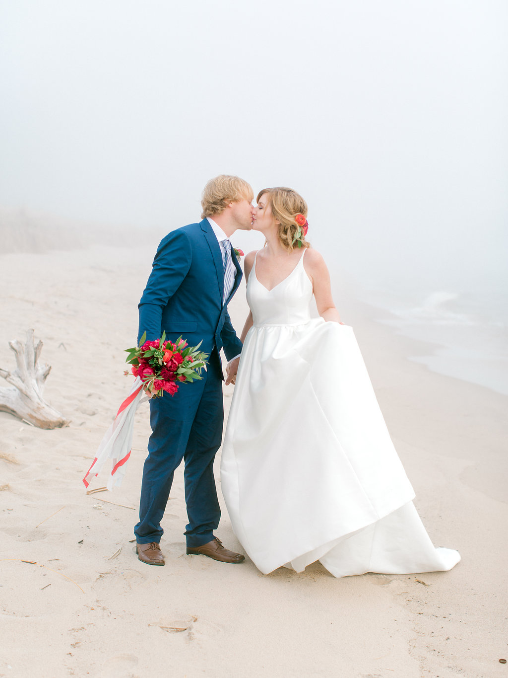 Couple kissing during their Lake Michigan wedding at Camp Blodgett