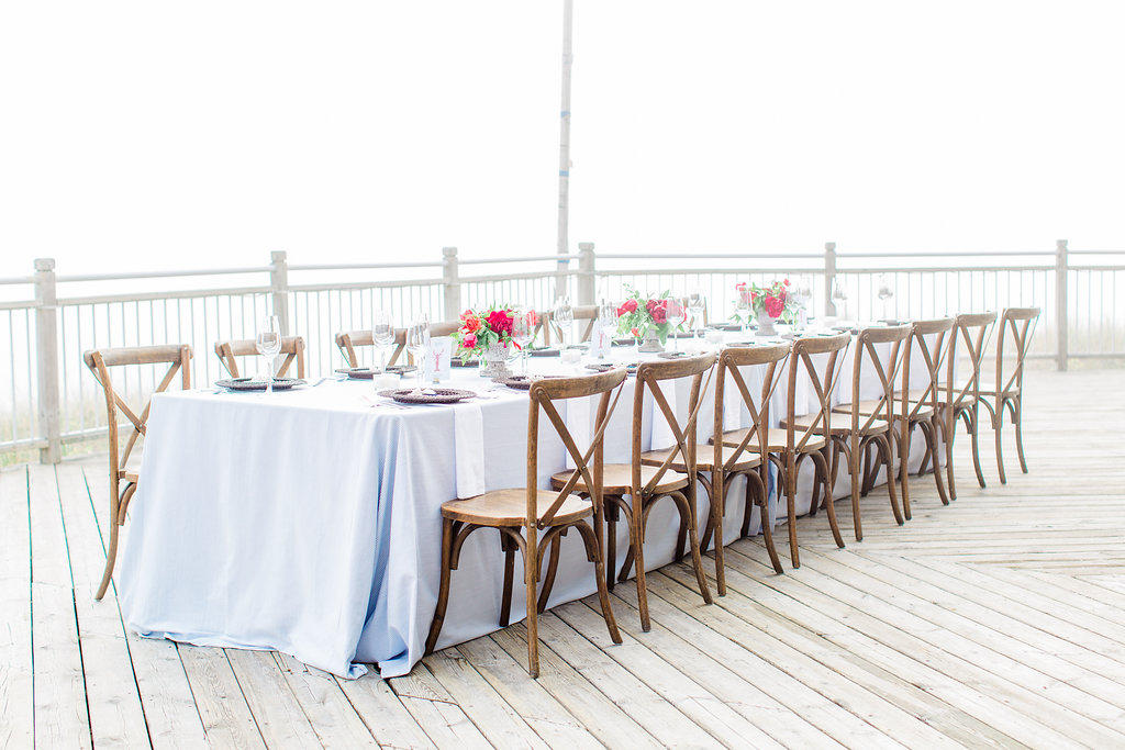 Table set on a deck for a Lake Michigan wedding
