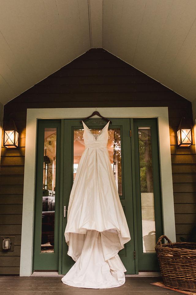 Wedding dress hanging from Door