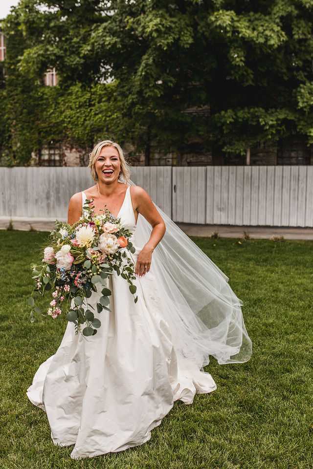 Bride smiling holding her bouquet