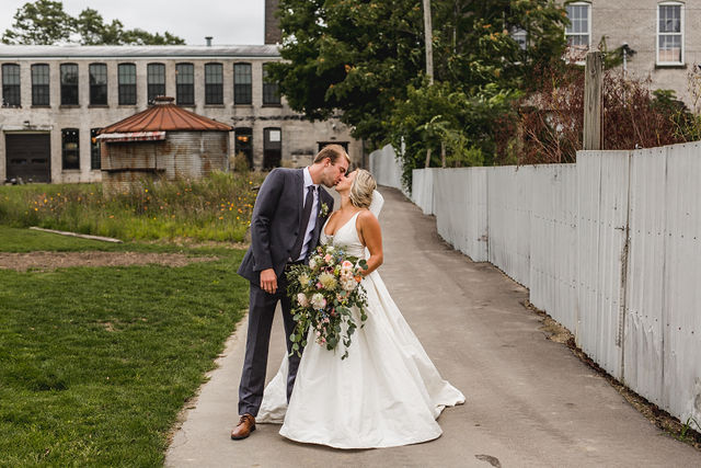 Bride and groom kissing at their Southwest Michigan wedding venue