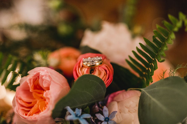 Rings sitting on flower of bouquet