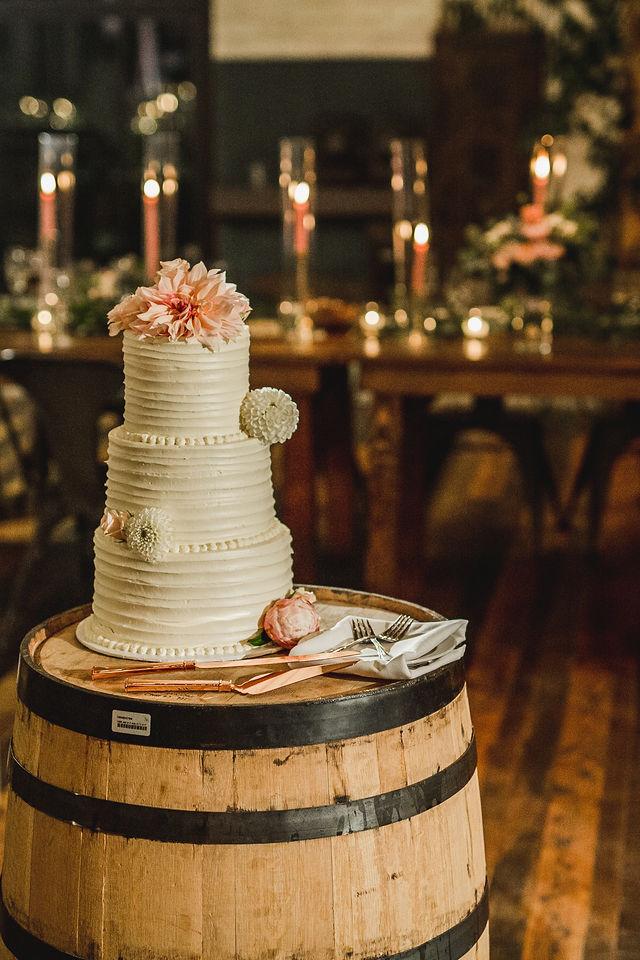 Wedding cake sitting on barrel at Southwest Michigan wedding venue