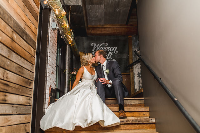 Bride and groom kissing in stairway of Southwest Michigan wedding venue