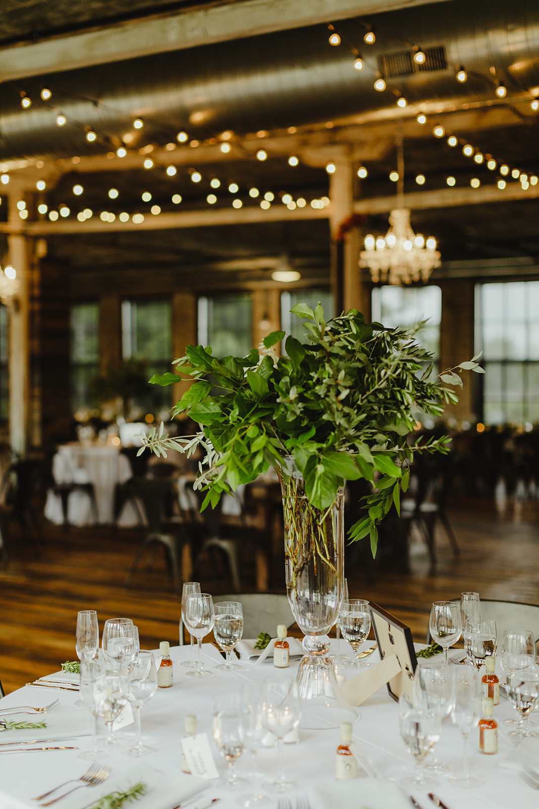 Tall greenery arrangements set for a Chicago destination wedding
