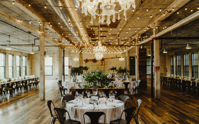 Tables set for a journeyman distillery wedding