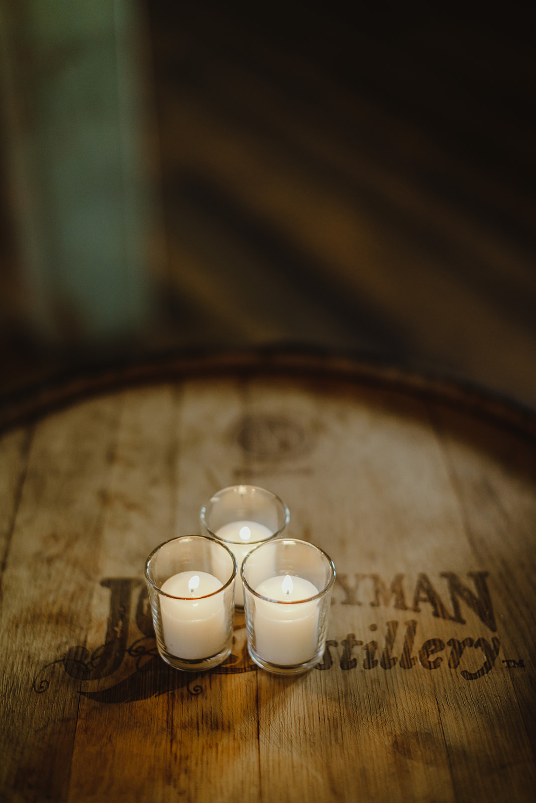 Candles on a whiskey barrel