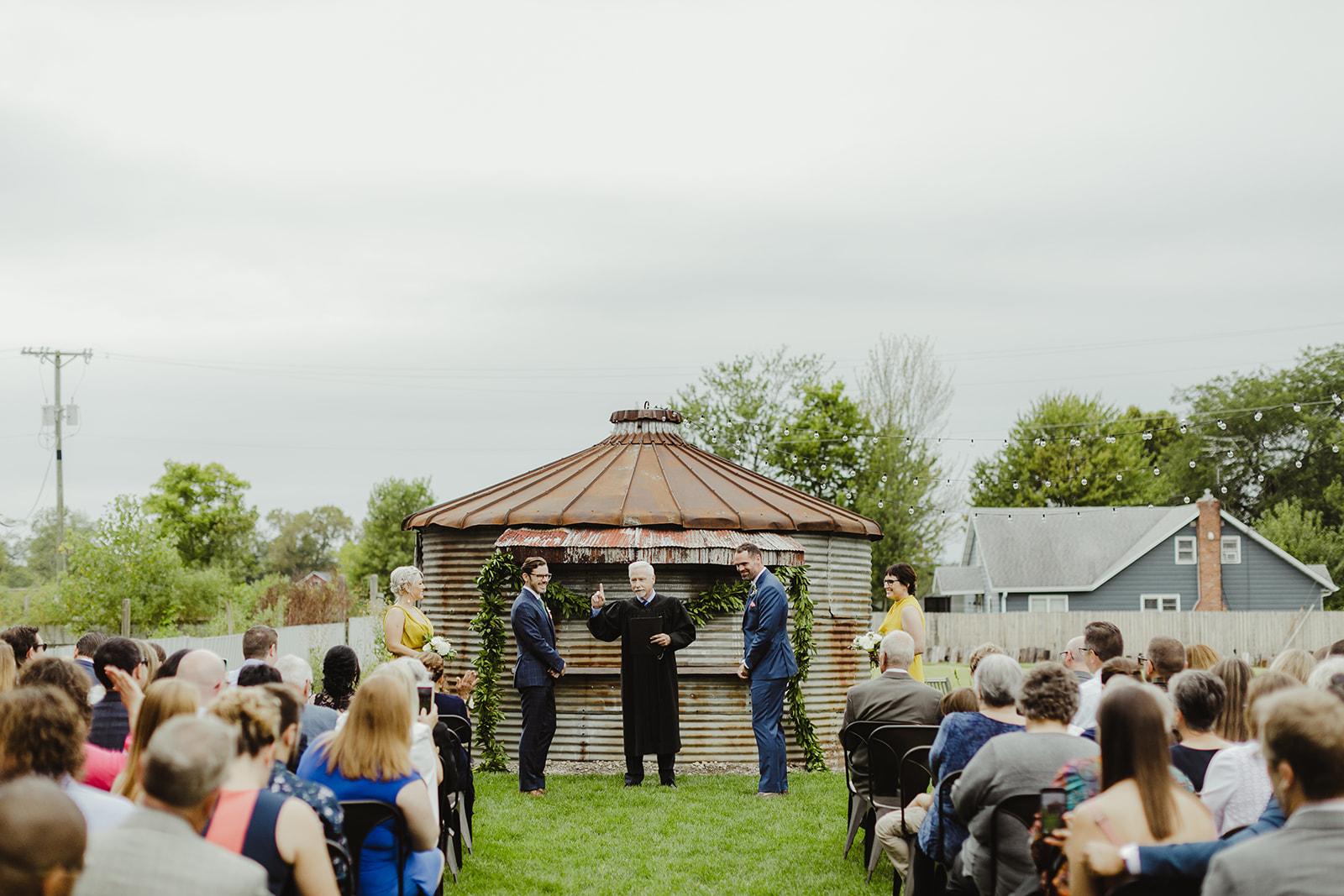 Grooms getting married during a Journeyman Distillery wedding