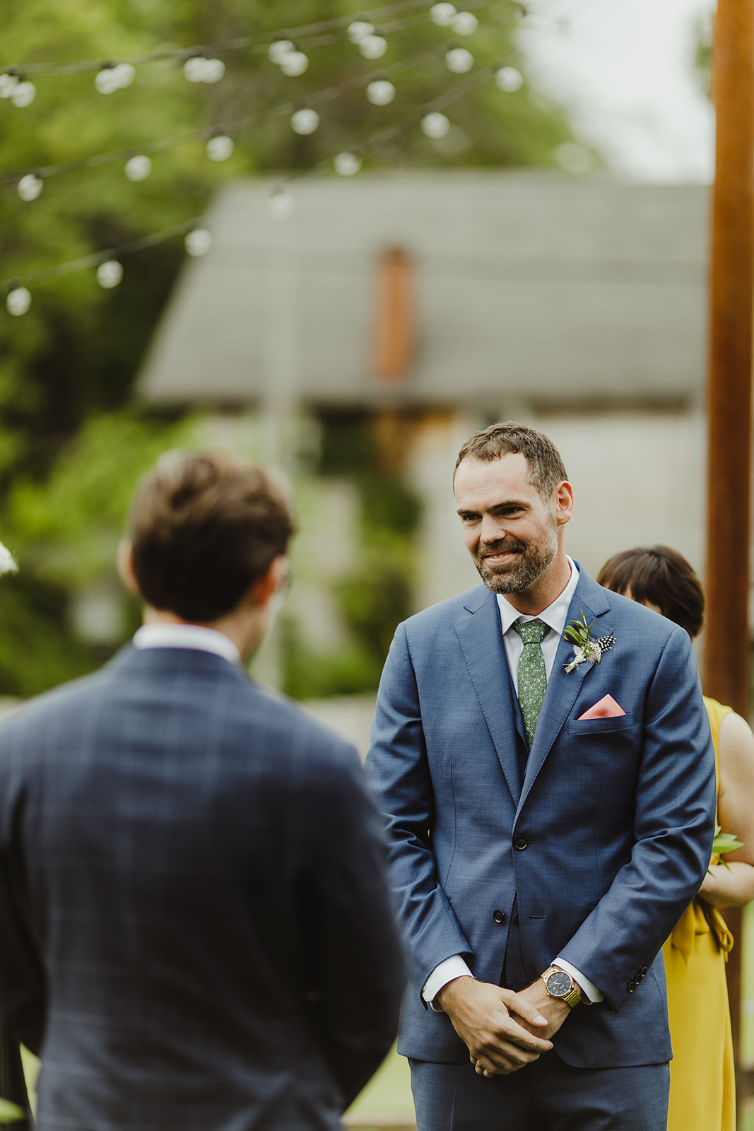 Groom smiling during his wedding