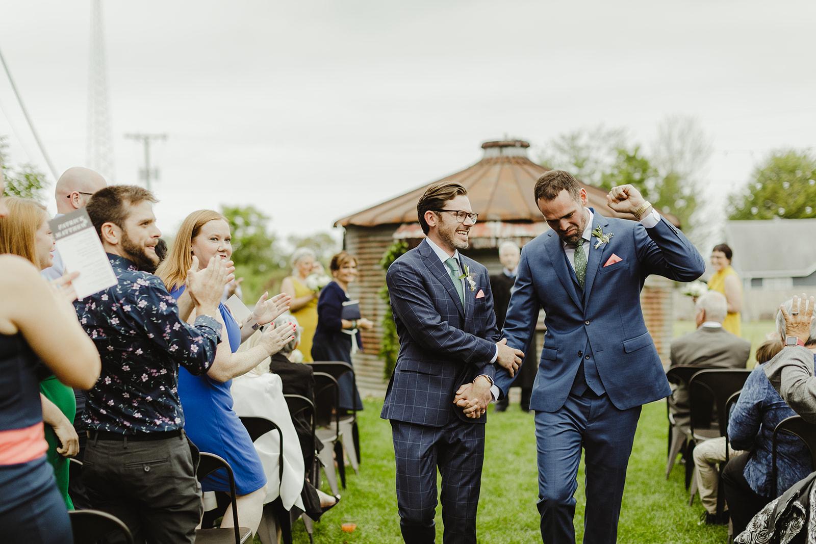 Grooms celebrating after their Journeyman Distillery wedding