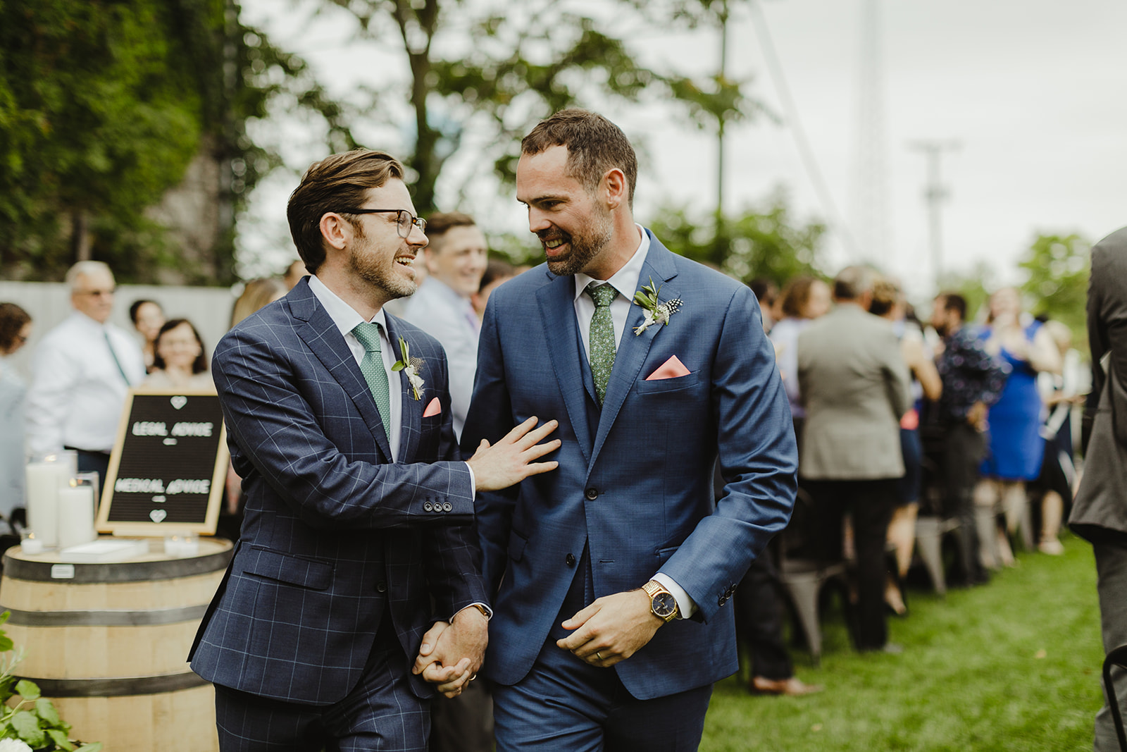 Grooms celebrating after their wedding ceremony