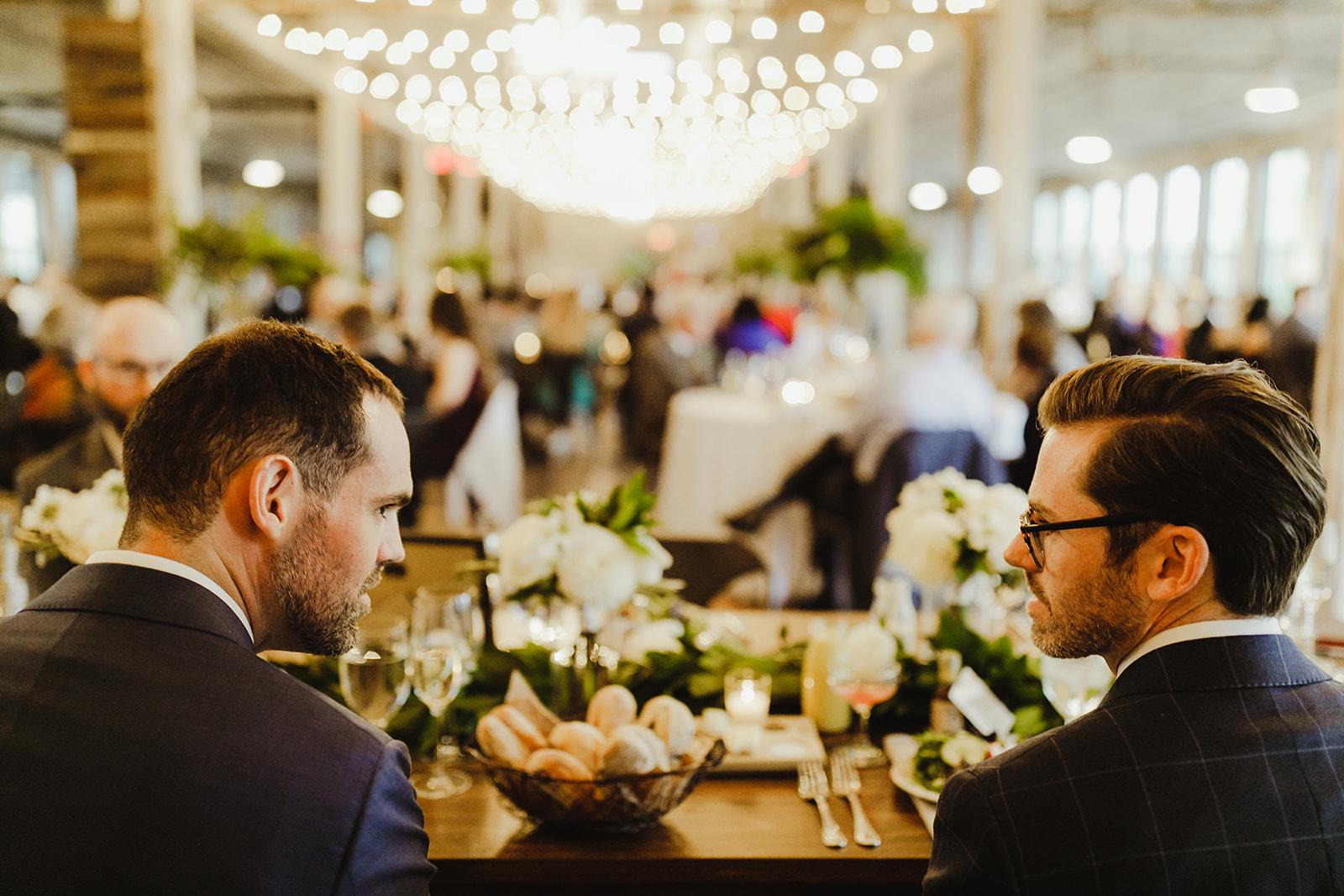 Grooms enjoying their Journeyman Distillery wedding reception