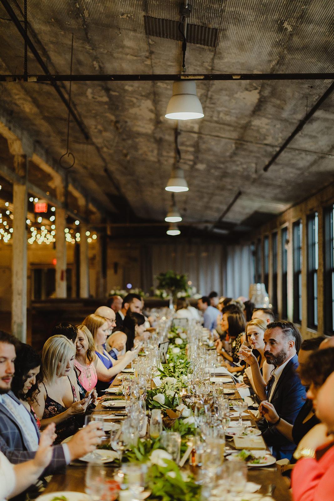 Guests enjoying dinner during a Journeyman Distillery wedding