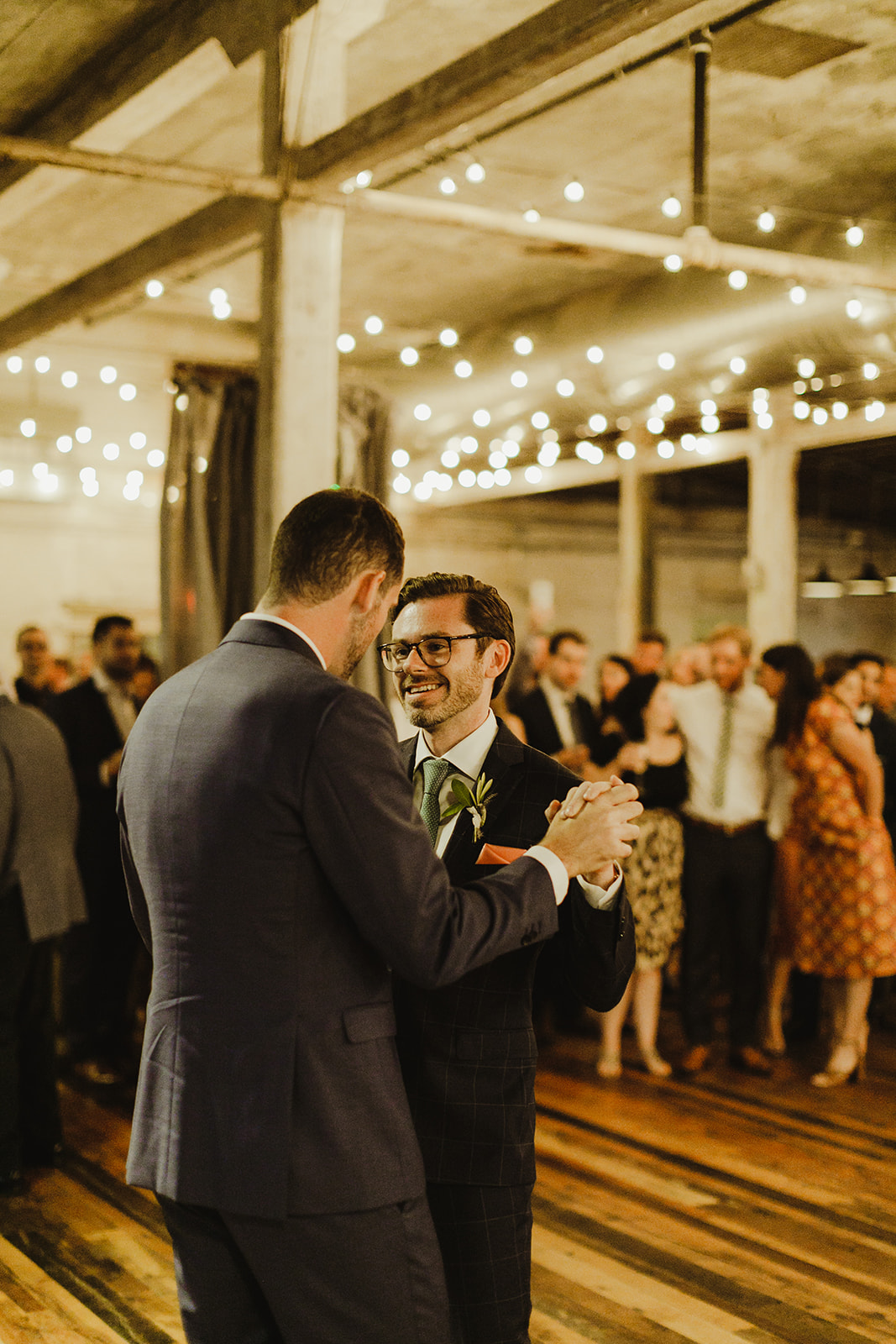 Grooms sharing their first dance