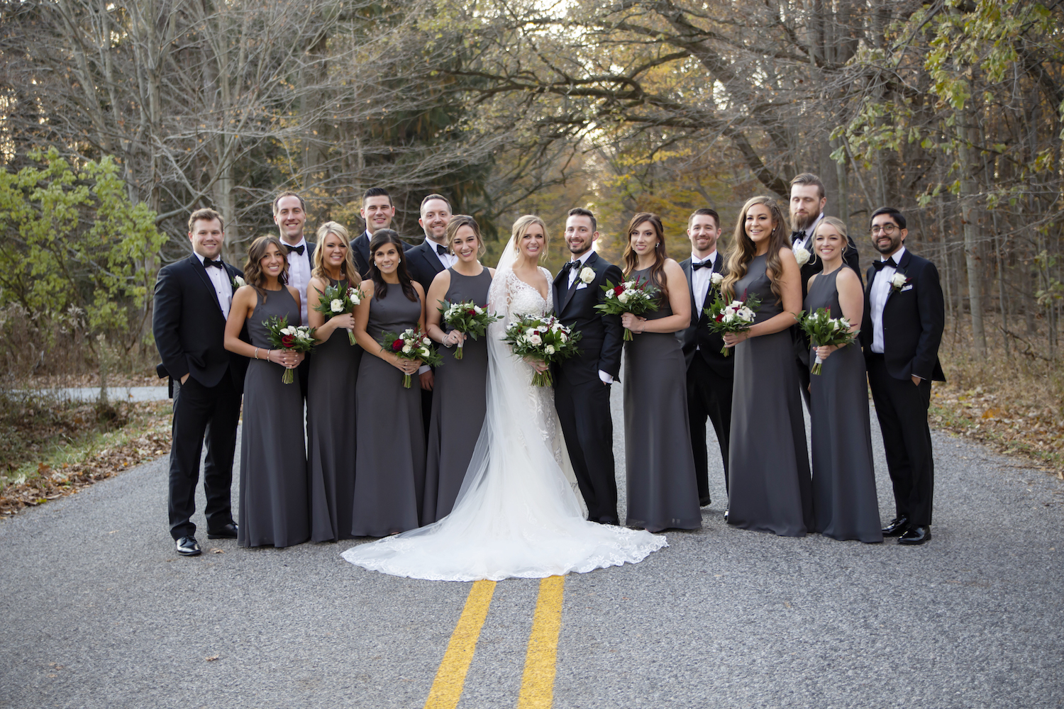 Bridal party standing on road for rustic Michigan wedding