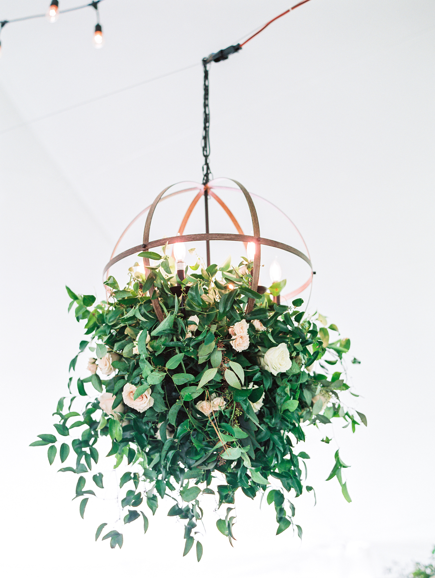 Floral chandelier at apple blossom resort wedding