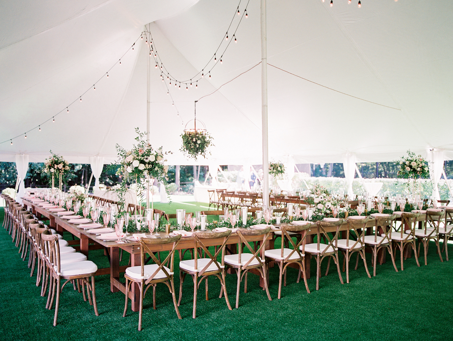 Table layout under tent for apple blossom resort wedding