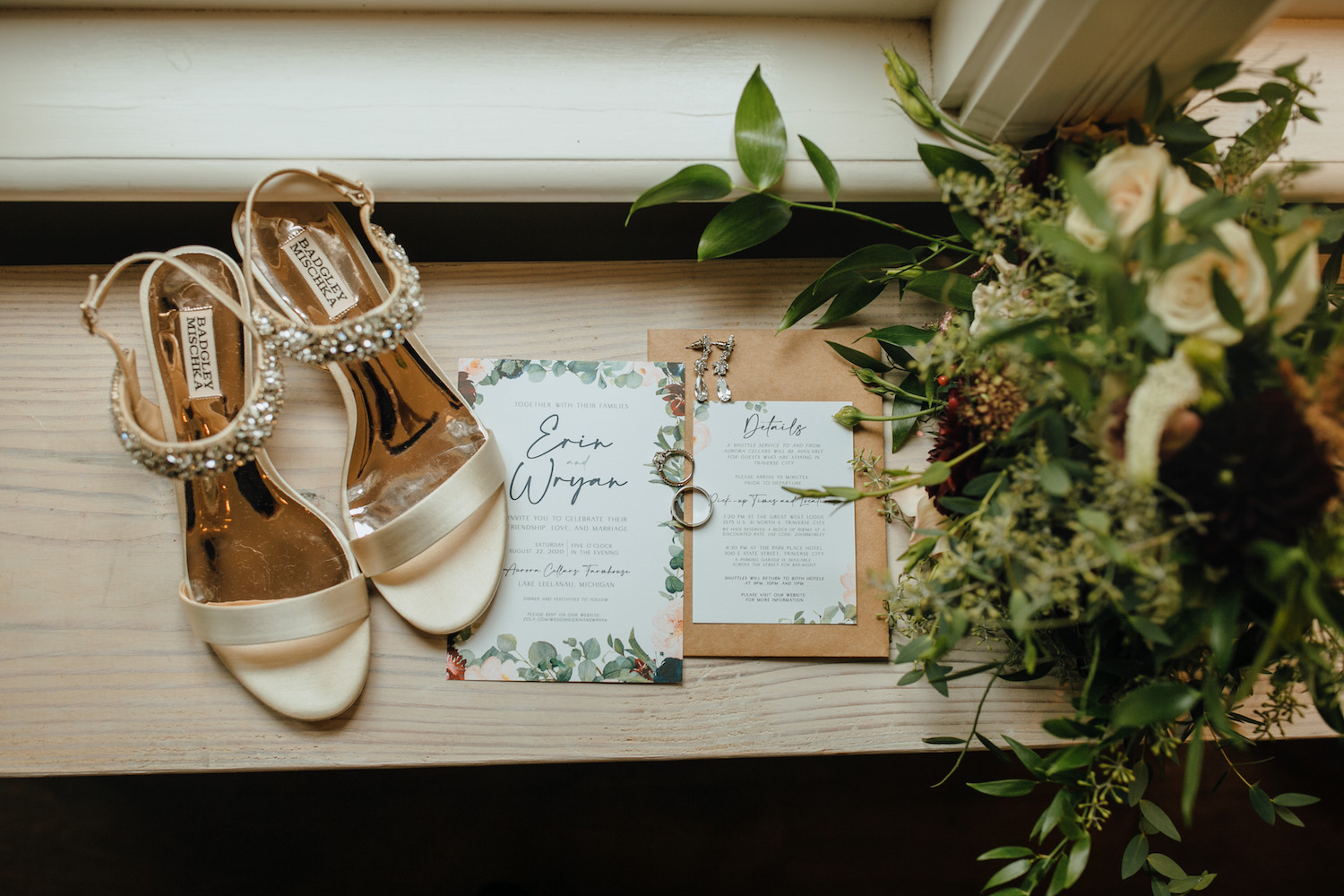 Detail shot of brides shoes, bouquet, and rings