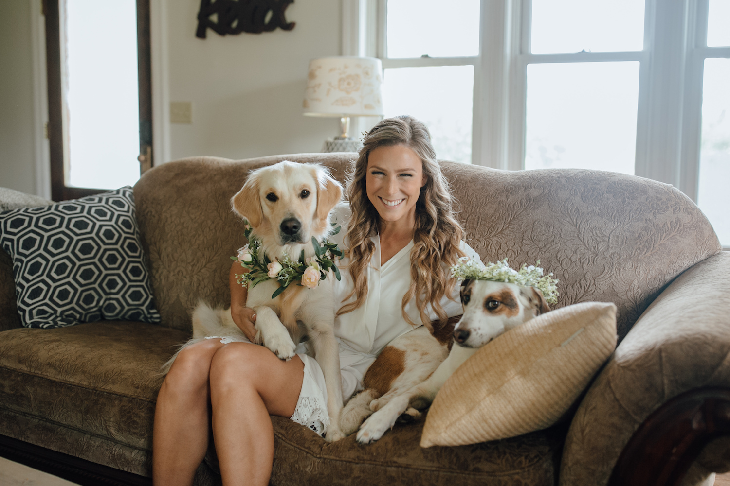 Bride smiling with her dogs