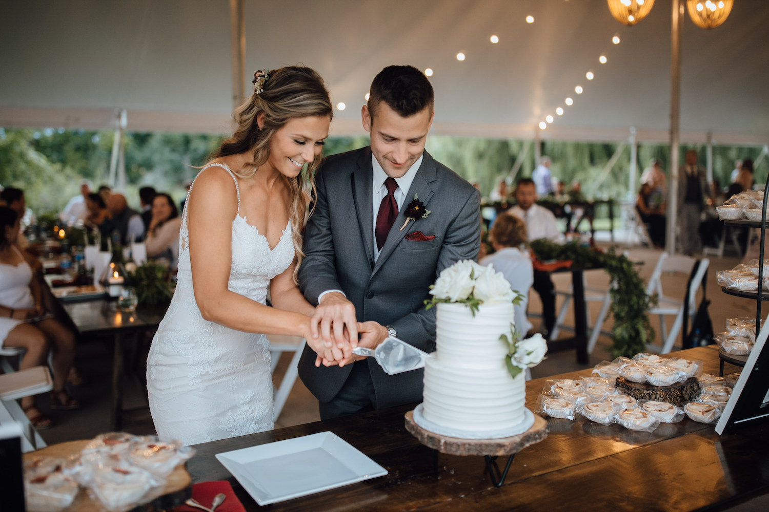 Bride and groom cutting cake at their aurora cellars wedding