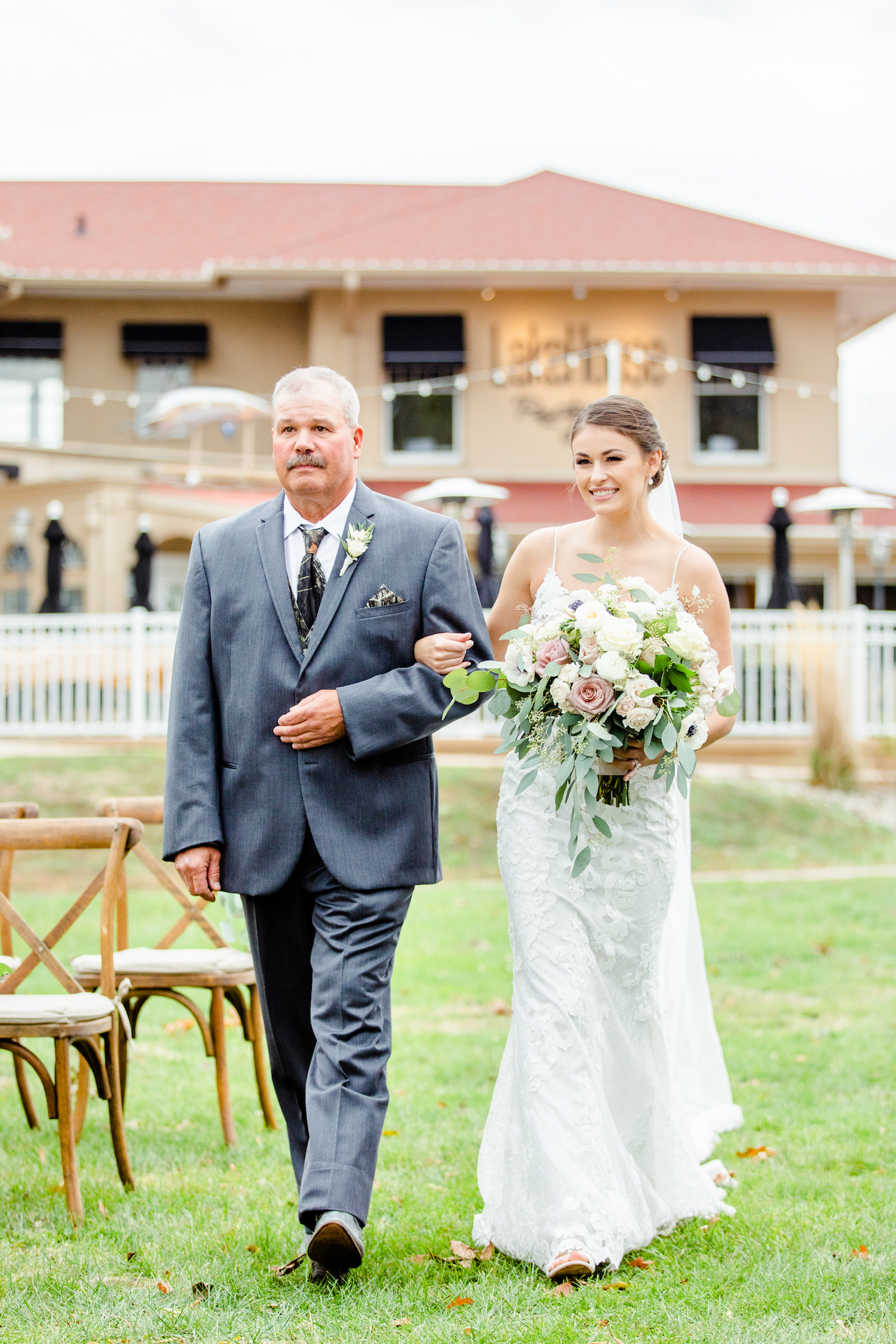 Bride and father walking down aisle for the lakehouse wedding