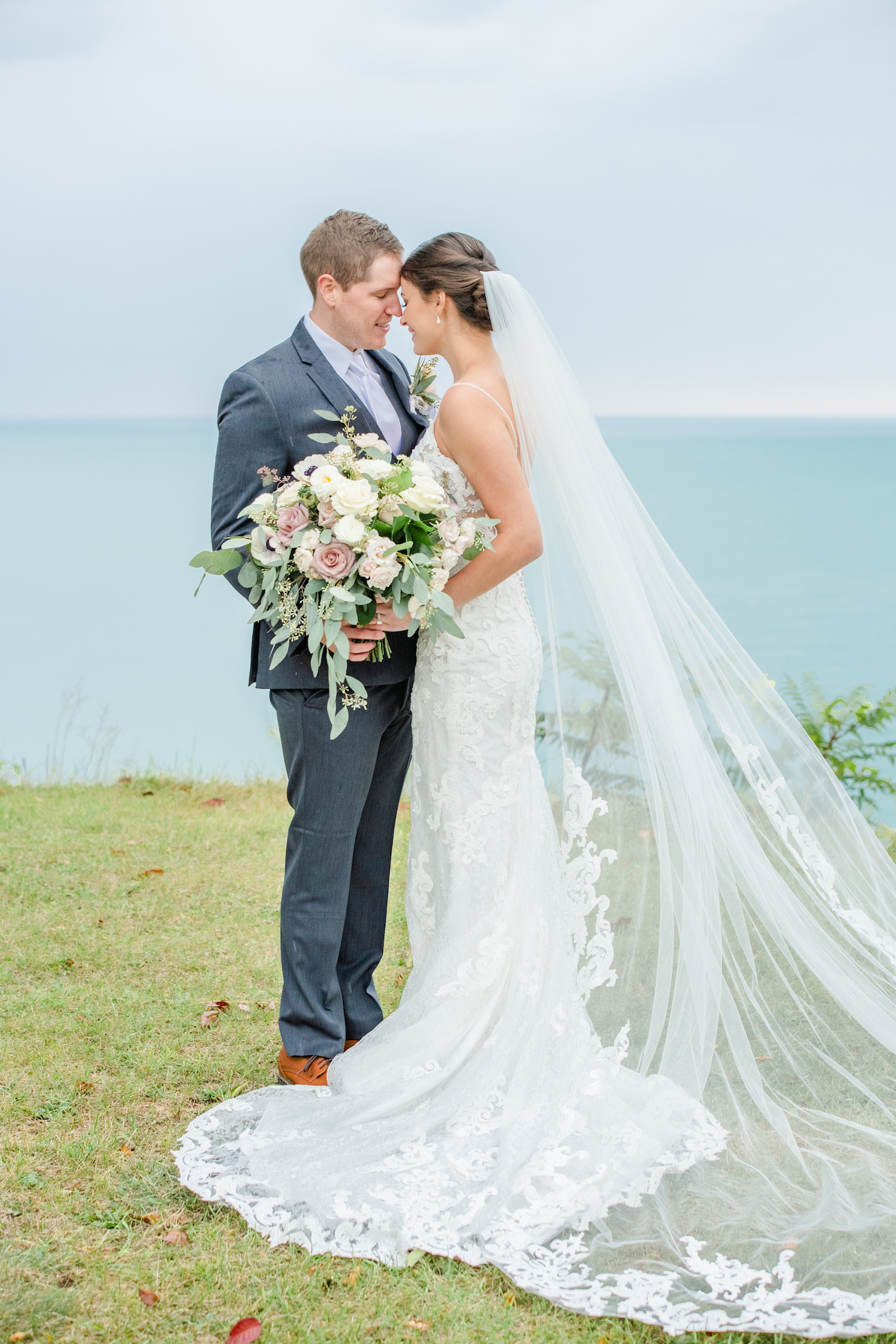 Bride and groom touching foreheads at the lakehouse wedding