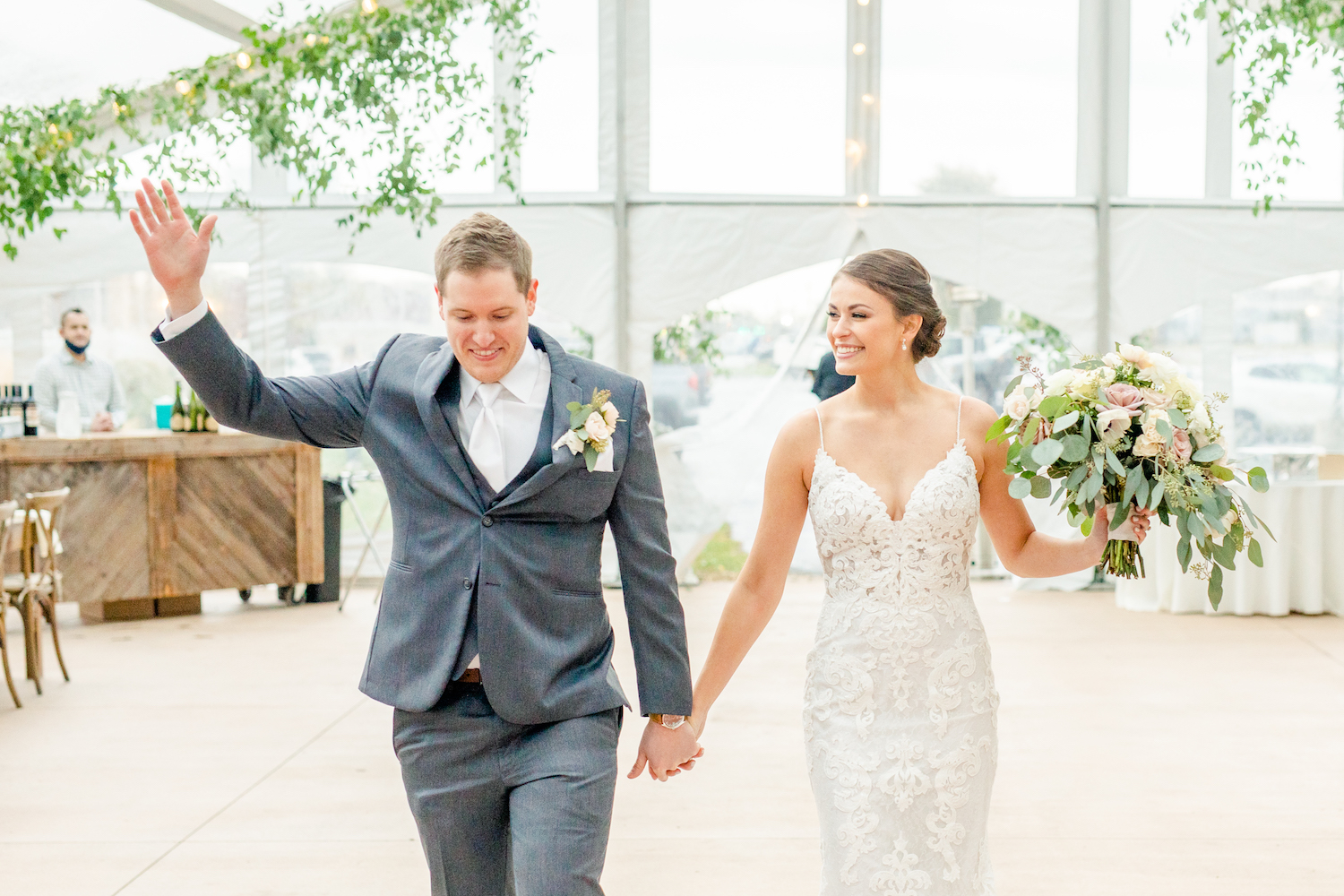 Bride and groom introduced at the lakehouse wedding